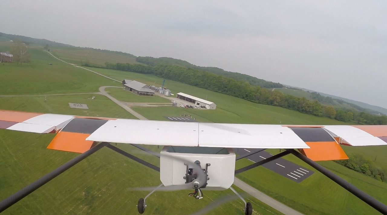 Image from a tail-mounted video camera showing the first ever flight of flexible matrix composite (FMC) flaps. The pneumatically powered flaps were developed and integrated into the eSPAARO UAS by a team of undergraduates during the 2014-2015 academic year, under the guidance of two faculty members (Craig Woolsey and Michael Philen) and two graduate students (Chris Kevorkian and Brady Doepke). Aspects of the project have appeared in three conference papers, earning two first-place awards.